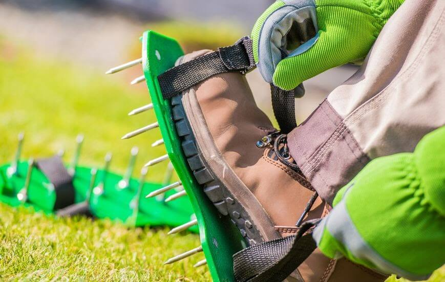 Spike aerator shoes used on Kansas City, MO lawn